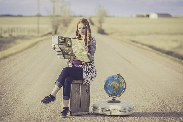 Woman Travelling with Globe